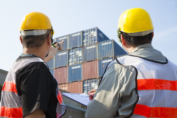 Workers checking shipping containers