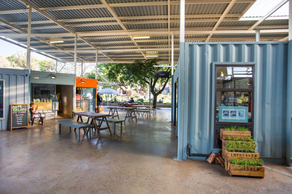 Used shipping containers repurposed as food stalls can be more affordable than traditionally constructed food stalls