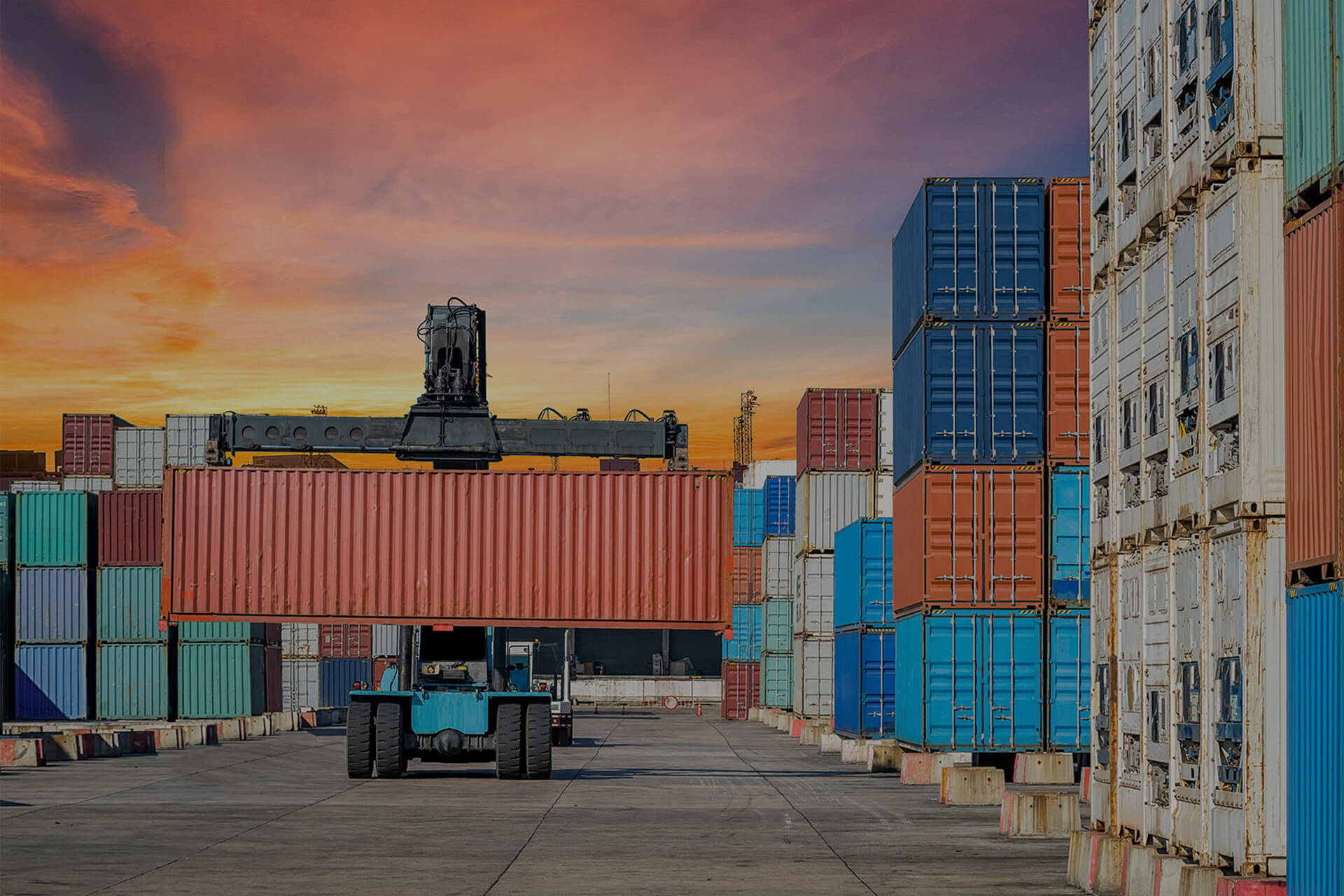 transporting cargo containers at a shipping yard